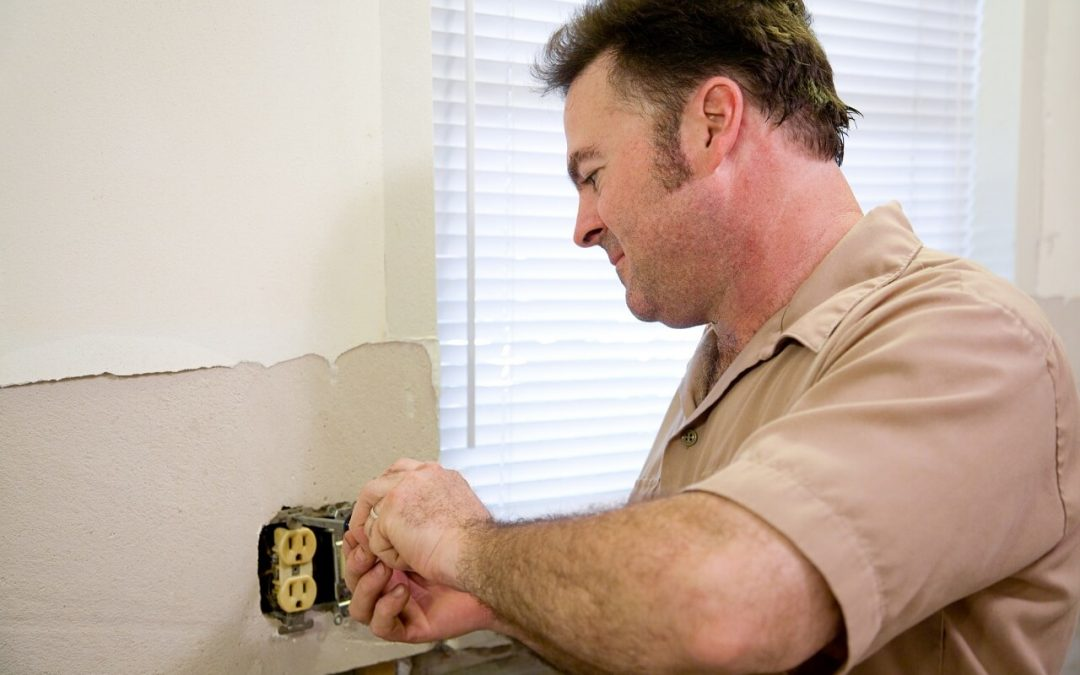 a professional electrician repairs an issue with electrical safety in the home